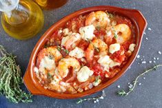 Prawn Saganaki is Greece's famous seafood dish featuring prawns drenched in a . - Prawn Saganaki is Greece's famous seafood dish featuring prawns drenched in a fresh juicy tomato s - Frozen Appetizers, Yummy Appetizers, Shrimp Saganaki Recipe, Greek Bread, Frozen Seafood, Shellfish Recipes, Shrimp Recipes, Baked Shrimp, Greek Dishes