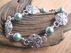Beach Bling Silver Sand Dollar and Sea Foam Faux Pearl Segmented Chain Bracelet - pinned by pin4etsy.com