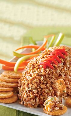 What's more welcome at a game-day party than a cheese ball? A cheese ball that looks like it belongs in the game, of course. Three cheeses team up for some serious yum.