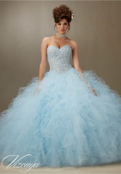 Quinceanera dresses by Vizcaya Pearl Beaded Bodice on a Ruffled Tulle Ball Gown Matching Bolero Jacket included.Colors: Light Purple, Light Blue, Blush, White.
