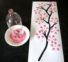 Cute way to paint flowers! Just use an empty pop bottle and dip it in paint and go! =) Good recycling technique, as well! =) by CESYY