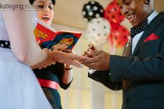 """As per our request, our officiant read from a journal with a drawing of Wonder Woman on the cover. My family noticed this right away since I was obsessed with the Linda Carter version when I was a kid."""