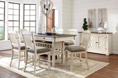 Fall in love with the Bolanburg Antique White 11 Pc. Reclining Dining Room Counter Table, 6 Upholstered Barstools, Dining Room Server & 3 Display Cabinets from Signature Design by Ashley at Furniture City, Fresno, CA. Round Dining Room Sets, Dining Room Server, Counter Height Dining Table, Dining Table In Kitchen, Dining Tables, Bar Tables, Dining Area, Dining Table With Storage, Dining Chair