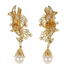 A pair of diamond and cultured pearl pendant ear pendants.