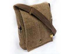 Thomas Tweed makes custom and bags out of vintage suit jackets and sports coats. This is a great way to get a one of a kind bag, repurpose a coat that is sentimental, or recycle a coat that no longer fits. Custom orders come with choice of brown, tan, black, grey, or natural straps, gold or silver hardware.    PLEASE NOTE: Even tho the bag shown here is sold, one can be made out of similar material (the lining may vary). Also, pins and pens only for display purposed.    Dimensions:  Main…