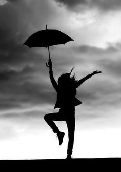 jumping umbrella holder in cloudy sky