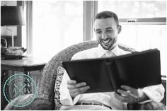 This groom's reaction to the boudoir album his bride gave him the morning of the wedding was AWESOME!  // Photo by Charleston , SC Wedding Photographers Aaron and Jillian Photography