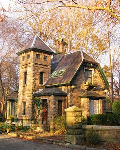 An old stone cottage in Rhode Island with lots of character & a woodland garden. Photography by Flickr Gingr