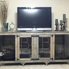 They turned their Doggie Den into a home entertainment center. Functional furniture is the best!