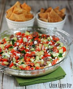 This Greek Layer Dip is your new potluck go-to! With tasty Sabra hummus, a thick and creamy Feta cheese layer, and Mediterranean vegetables tossed in a Greek vinaigrette, it's a flavor explosion you won't be able to get enough of. Ww Recipes, Sauce Recipes, Cooking Recipes, Light Recipes, Healthy Dips, Healthy Eating, Healthy Recipes, Healthy Meals, Yummy Appetizers