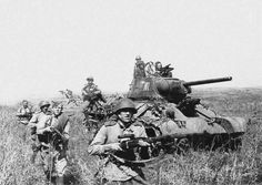 Soviet infantry advance alongside T-34 tanks. Summer 1944 [via]