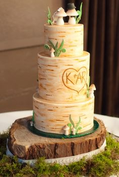 Photo credit: Basia Baz Photography http://basiabazphotography.com/ Buttercream birch | custom toppers | mushroom bride | mushroom groom | fiddleheads | pnw | seattle | fondant mushrooms