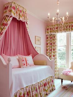 A daybed with a canopy, a simple girly chandelier and some frills make this kids bedroom a little girls dream.