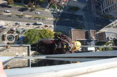 A Woman in a Wheelchair Rappels