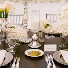 "The dark-wood tables were natural yet formal, and leaving them bare ""allowed the flowers, candles, glassware and silverware to really sing,"" Sacks says."