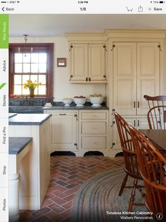 Love the cabinets, soapstone, and hidden fridge (right side tall cabinet).