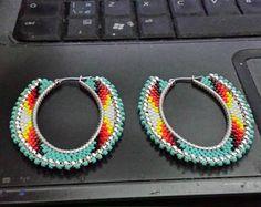Items similar to Native American Beaded Horseshoe Earrings on Etsy Native American horseshoe earrings from CreeativeIskwew Beaded Earrings Native, Beaded Earrings Patterns, Beaded Rings, Native Beadwork, Beaded Horseshoe, Horseshoe Earrings, Hoop Earrings, Native Beading Patterns, Beadwork Designs