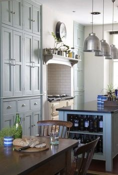 Modern Victorian style kitchen, full wall of cabinets (would be better as glass-front on upper cabinets)