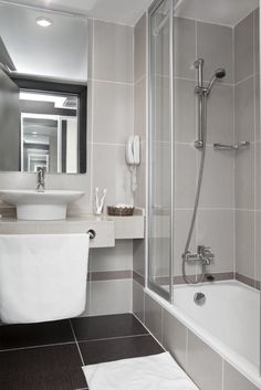 Calming Bathroom With Submersed Bathtub And Shower Combination