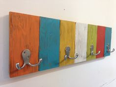 Handmade kids coat hook rack with vibrant, fun colors. Rustic, shabby chic from reclaimed wood with double hooks.