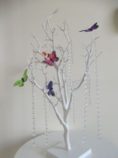 """White 30"""" manzanita wishing trees are great when it comes to wedding table decor. The manzanita trees or branches are accessorized with hanging crystals and Optional LED lights"""