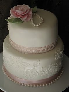 Very pretty cake with floral detail, ribbon edging and pearl detail.  ᘡղbᘠ