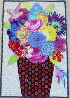 Pinkadot Quilts. Nice way to applique those large flower fabrics