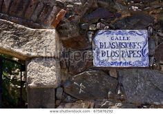 A plate and a brick wall in Calle de Las Misiones de los Tapes in Colonia del Sacramento, Uruguay.