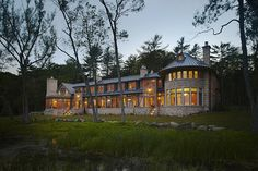 Lake House Retreat by Morgante Wilson Architects, love the curved rooms and the fabric wall/headboard treatment.