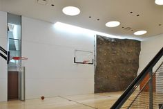 Home gym in a contemporary home, complete with basketball court and climbing wall. From PorterFanna.