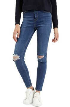 Free shipping and returns on Topshop Moto 'Jamie' Ripped Ankle Jeans (Mid Denim) (Regular & Short) at Nordstrom.com. Cut from ultra-stretchy denim for figure-sculpting flattery and optimal freedom of movement, these skinny blue jeans embody the grungy '90s with shredded knees and ankle-skimming hems.