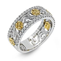 This lovely 18k gold band features an intricate floral design which is bordered by .41 ctw of white round brilliant diamonds.