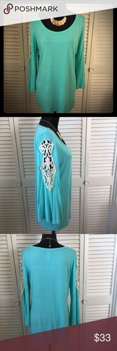 Beautiful top Teal Celeste top. Size 2X. Cream crochet detail in the sleeves. NWOT. Never worn. Tops Blouses