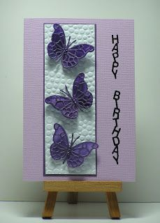 By Cathy Roffey. Butterflies die cut (Memory Box) from vellum painted with twinkling H2O's. Tiny Bubbles embossing folder.