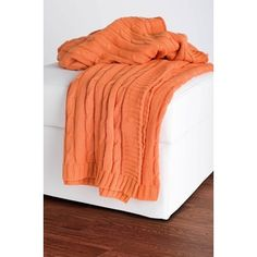 Orange cable knit sweater throw blanket / cozy interior design