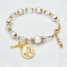 Made with genuine Swarovski crystals and pearls throughout. Beautiful 8mm Swarovski pearls and crystals, alternating white and clear crystal, represent the Hail Mary prayers. They are accented by gold-tone bead caps and spacer beads. In between them are Swarovski clear diamond-shaped