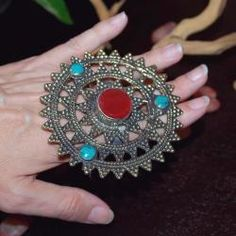 I have a blue one to these, awesome two-finger ring. Love it because it reminds me of Steampunk mixed with Tribal style.