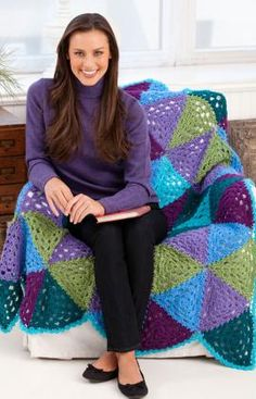Vibrant Granny Triangles Throw -- FREE crochet pattern at Red Heart.  I love the different take on a granny!