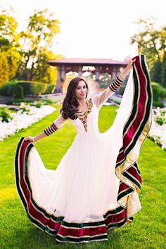 Bridal white and red princess seams anarkali swept full circle skit, thick long brown hair.