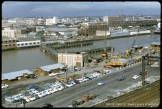 Looking across to where Crown Casino is now. The King St bridge is under construction. 1958.