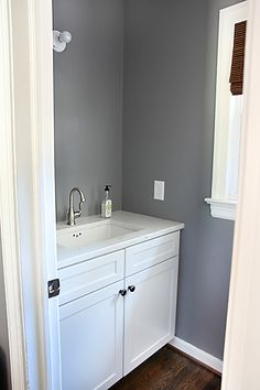 Half Bathroom Progress // 7thhouseontheleft.com --- Wall color:  Anonymous, Behr and white painted cabinet.