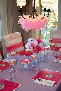 boa & pearl-draped chandelier, dollar store table cloth wrapped chairs + tulle, $ store flowers (tulle covers stems), awesome marshmallow pops