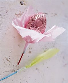 Skewered foiled-covered chocolate egg, tissue flower - make several for small bouquet. (no link- old file pic of mine)