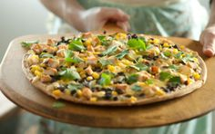 You can't go wrong with the best of family favorites, pizza and Mexican food, in one meal! For a vegetarian version, simply substitute cooked zucchini or bell peppers and onions for the chicken. If you only have two mouths to feed, serve half of the pizza for dinner and pack the leftovers for lunch the next day.
