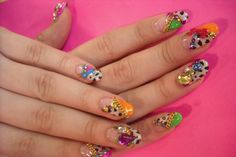 Not crazy about the design, but love the colors. Nails by artist Naomi Yasuda.
