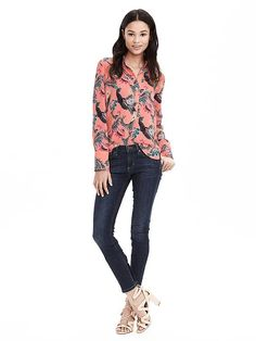 Add this soft crepe bird patterned blouse with high/low hem into your winter wardrobe for an extra pop of color   Banana Republic