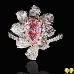 The perfect pink, exquisite natural pear shaped fancy intense pink set amongst the most beautiful pear shaped diamonds another magnificent piece from our designers at #Novel! #NovelCollection