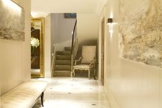The pearlised walls and polished marble floor were selected by Intarya to bounce the light around the hallway.