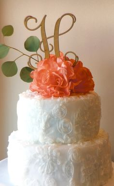 LOVE this unfinished cake topper by Inscribed Monograms with coral flower by Paper Heart Blooms.