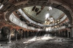 Niki Feijen, Disciple of Decay. Former splendour: Sunlight beaming through holes in the roof highlights the faded grandeur of this dilapidated building
